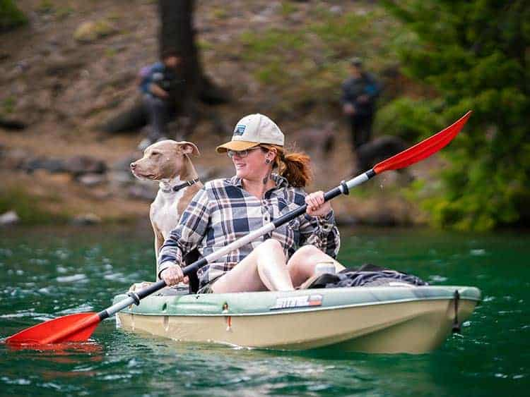 Kelly kayaking with her dog